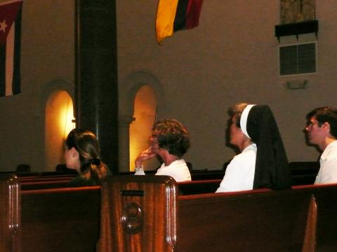 Staff members listened intently to the presentation on stained glass in the Chapel.