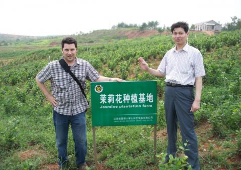 Brian Durkee with one of his suppliers at a Jasmine flower farm in China.