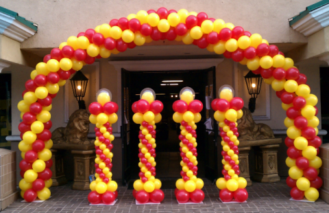 balloon arch and balloon towers in red and yellow