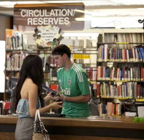 check out materials from the circulation desk