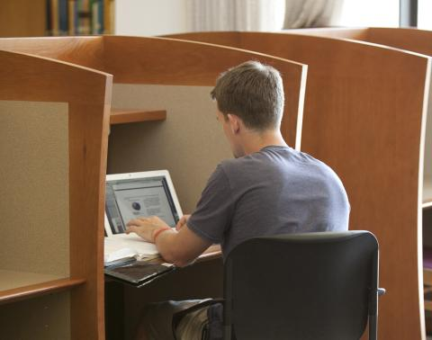 student in cubicle