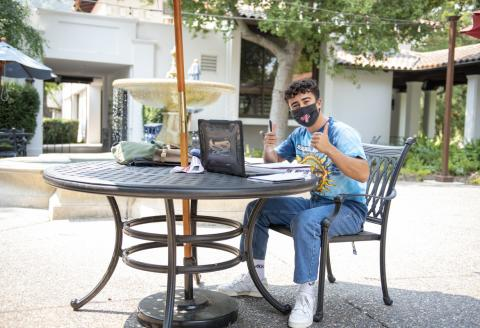Student sitting at a table studying