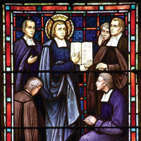 stained glass window depicting Saint John Baptist de la Salle teaching early Christian Brothers