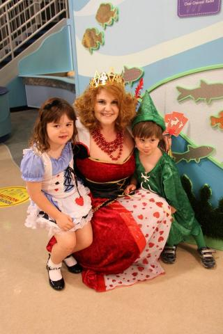 "Carole Richardson-Becker (the Red Queen) with daughter Ainsley (Alice) and son Jackson (Peter Pan). Jackson was going to round out the trio as the Mad Hatter, but, as Carole says, ""3-year-olds tend to be unpredictable!"""