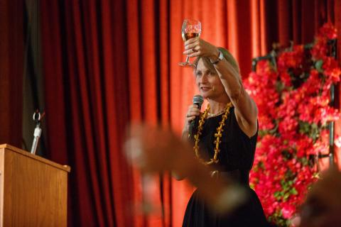 Provost Dobkin raises her glass in a toast to Brother Ron.