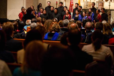 The Saint Mary's Chamber Singers perform at Convocation as the audience listens.