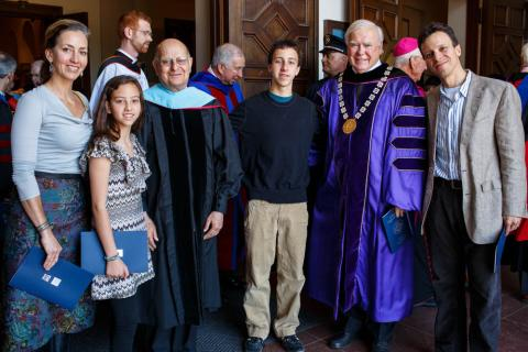 Brother Alvaro gathers with Brother Ronald and members of a Gael family.