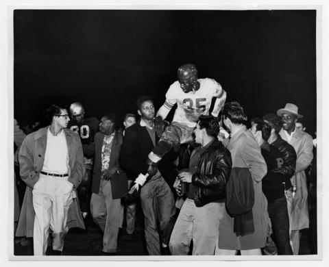 Johnson being carried off the field at Saint Mary's