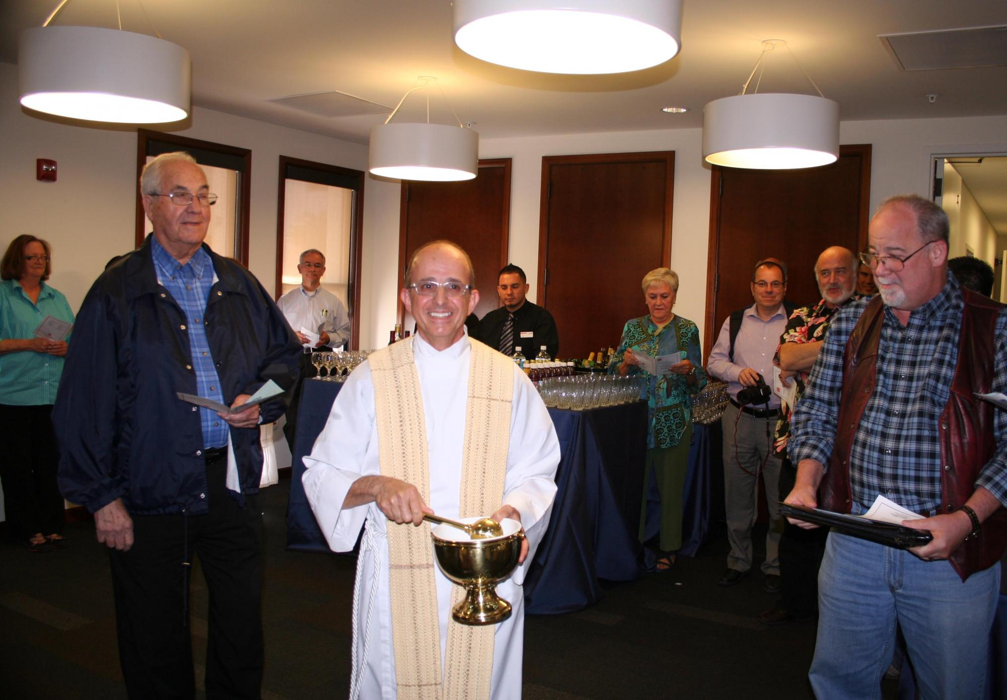 Father Salvatore Ragusa blesses the new Psychology Center