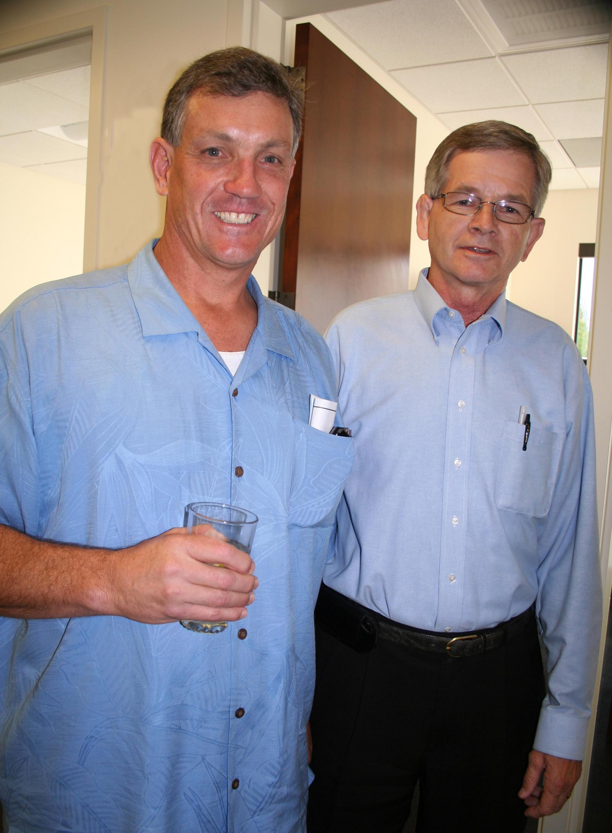 Kevin Shea (left), who graduated from SMC in 1979, was the construction supervisor for the Psychology Center. At the reception, he reconnected with Joe Kehoe (right), head of Facilities Services, who was his coach when he played football for Saint Mary's.