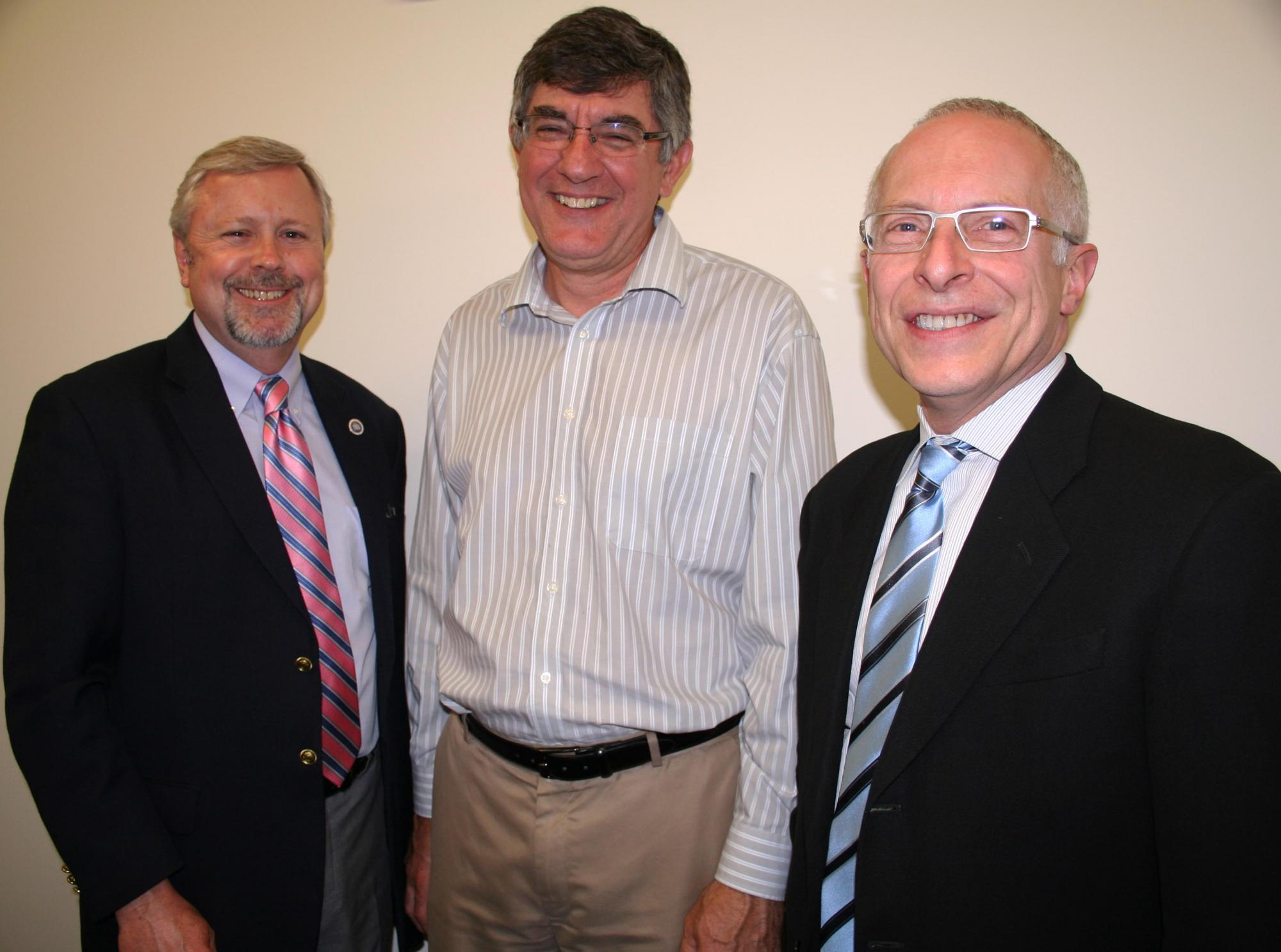 Vice President for Finance Pete Michell and Dean Wensley spoke with Gary Schilling (right) of BAR Architects, which designed the center.
