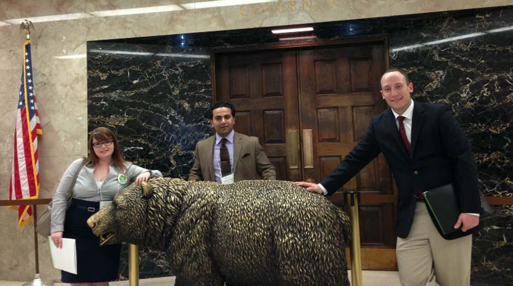 SMC students Jessi Bailey '15, Riley Hopkins '13 and Mostafa Wassel '13 in front of the governor's office.