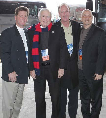 Brother Ron with members of the Athletic Department staff in Michigan
