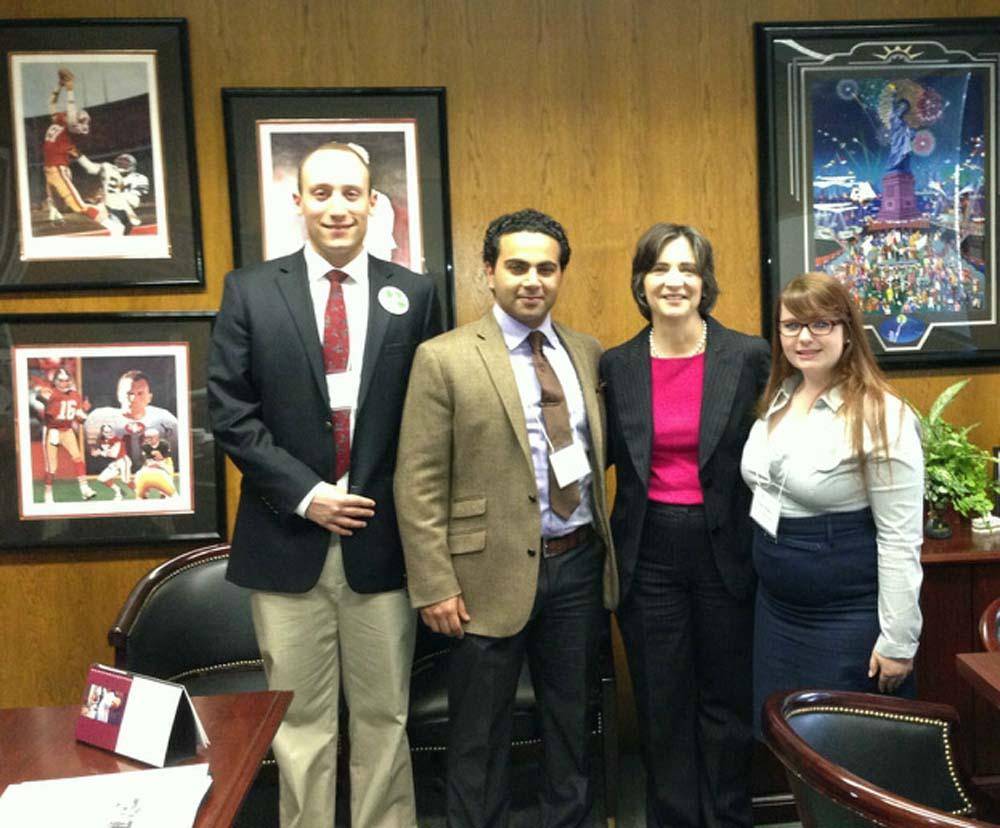 Riley Hopkins, Mostafa Wassel and  Jessi Bailey with Assemblymember Joan Buchanan.