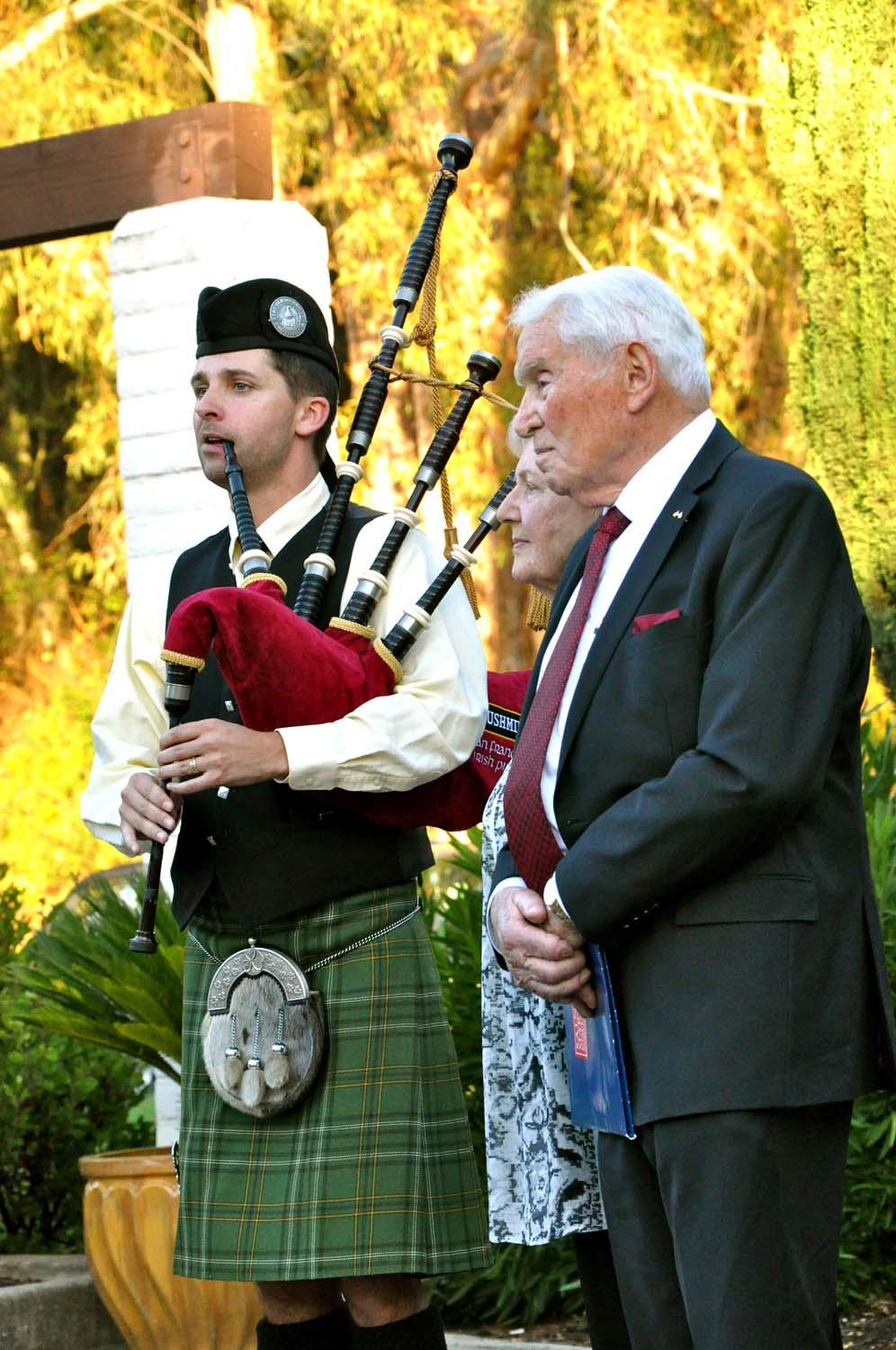 A piper with John Joseph Patrick Moylan and his wife.