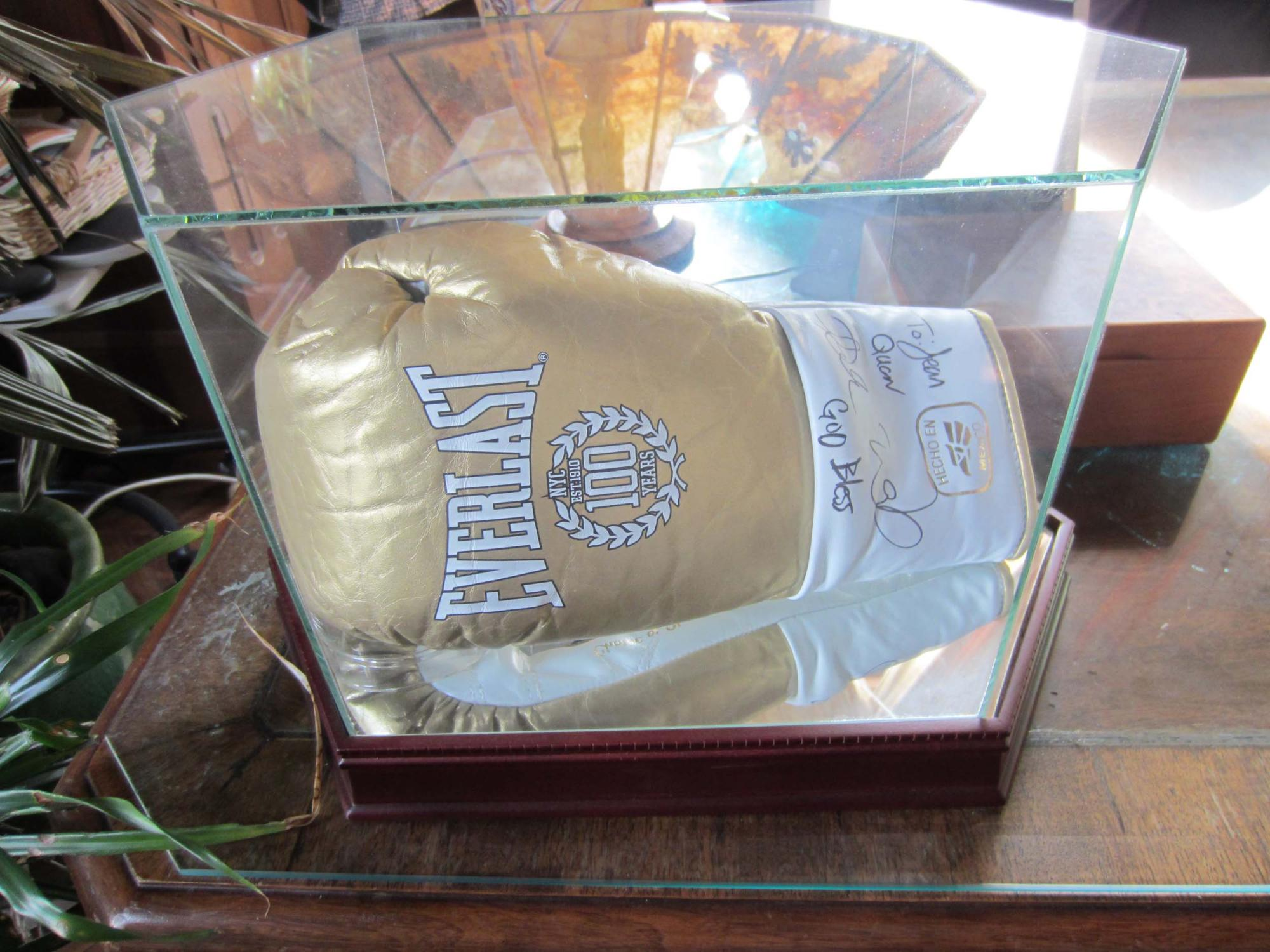 Boxing glove presented by Oakland Olympic gold medalist Andre Ward to Mayor Jean Quan.