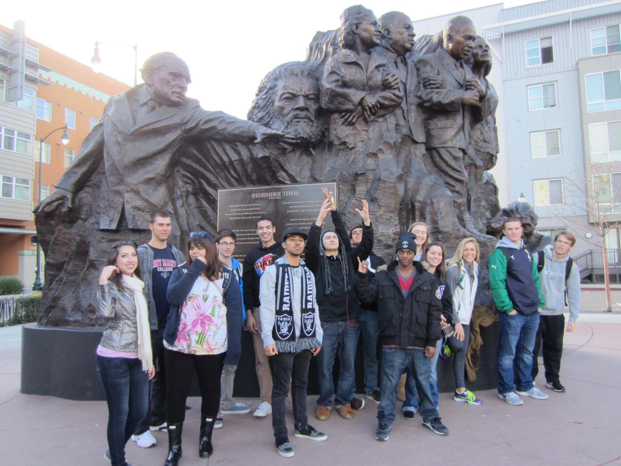 """Students at Mario Chiodo's """"Remember Them"""" memorial to world humanitarians in Fox Plaza downtown."""
