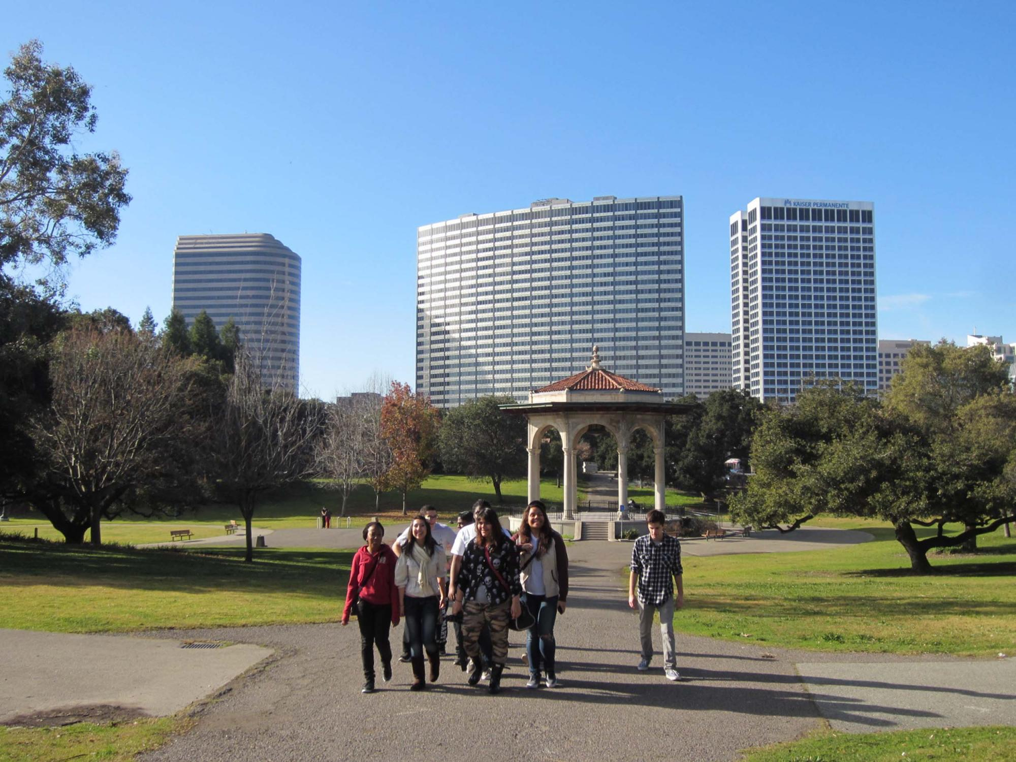 Walking through Lakeside Park, with the Kaiser Center and the Edoff Memorial Band Stand seen in the background.