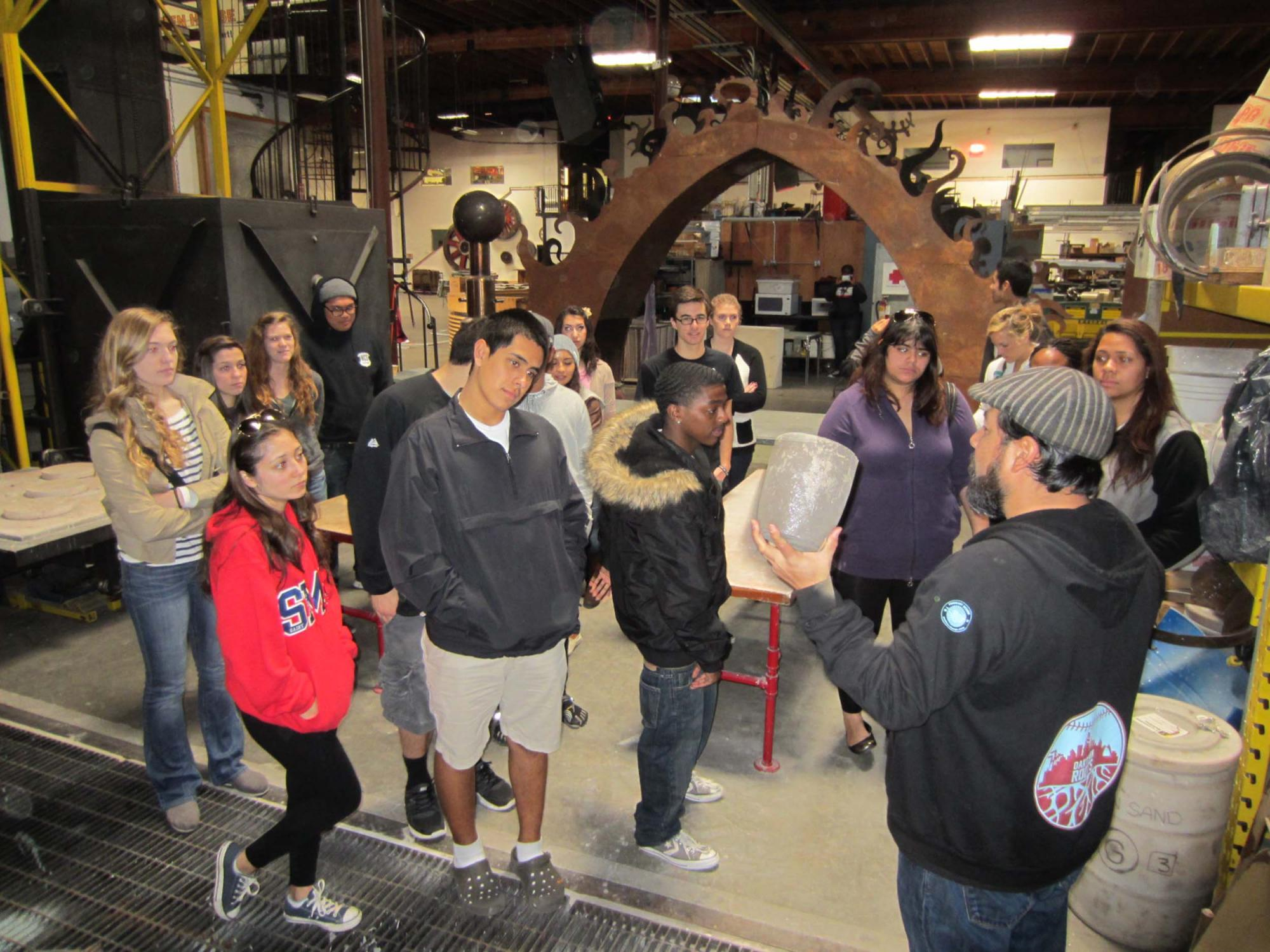 Students tour The Crucible industrial arts and education center in West Oakland.