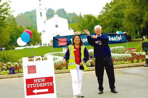 President Donahue helps direct student traffic
