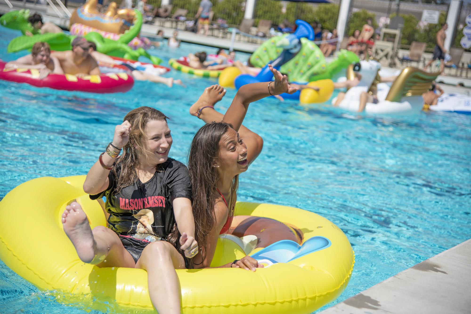 Students having fun at the campus pool party.