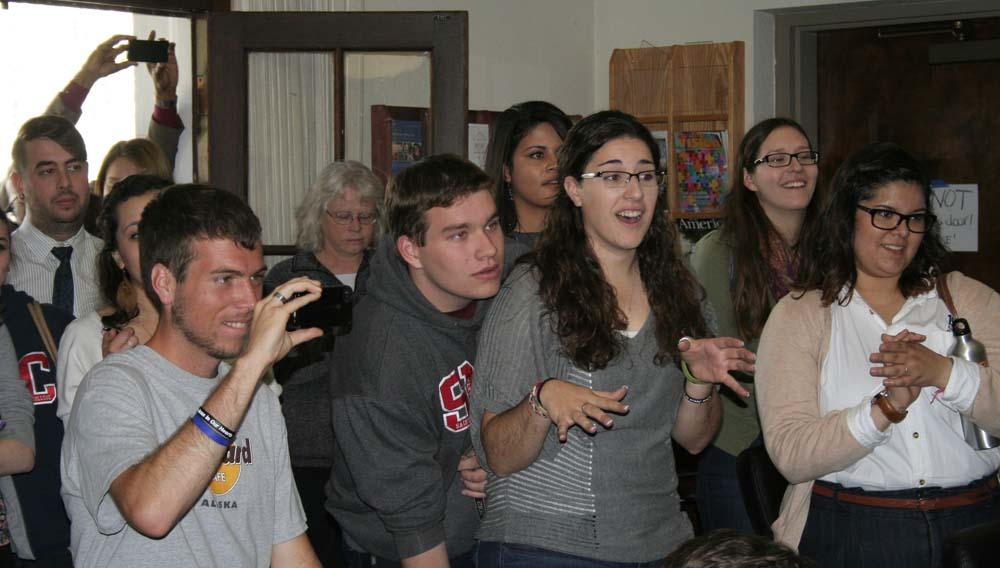 Students react with surprise when the name of Cardinal Jorge Bergoglio of Argentina is announced.