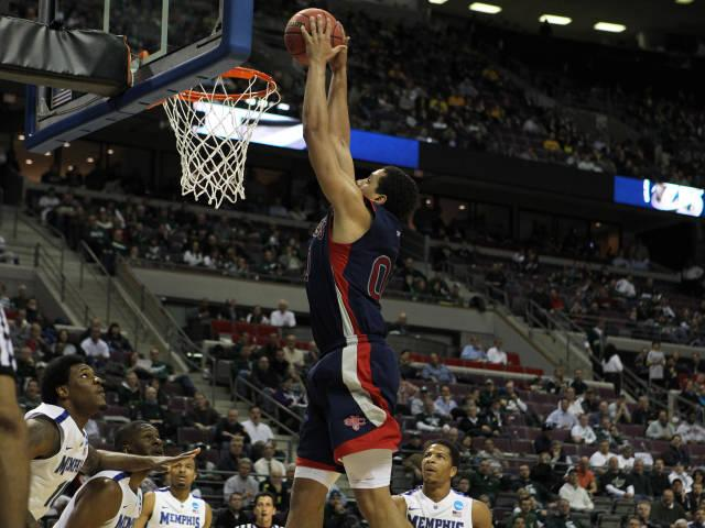 Brad Waldow dunks for two against Memphis in the Gaels' second-round 2013 NCAA Tournament game.