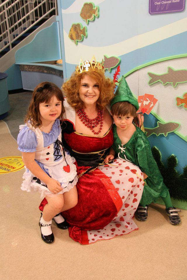 """Carole Richardson-Becker (the Red Queen) with daughter Ainsley (Alice) and son Jackson (Peter Pan). Jackson was going to round out the trio as the Mad Hatter, but, as Carole says, """"3-year-olds tend to be unpredictable!"""""""
