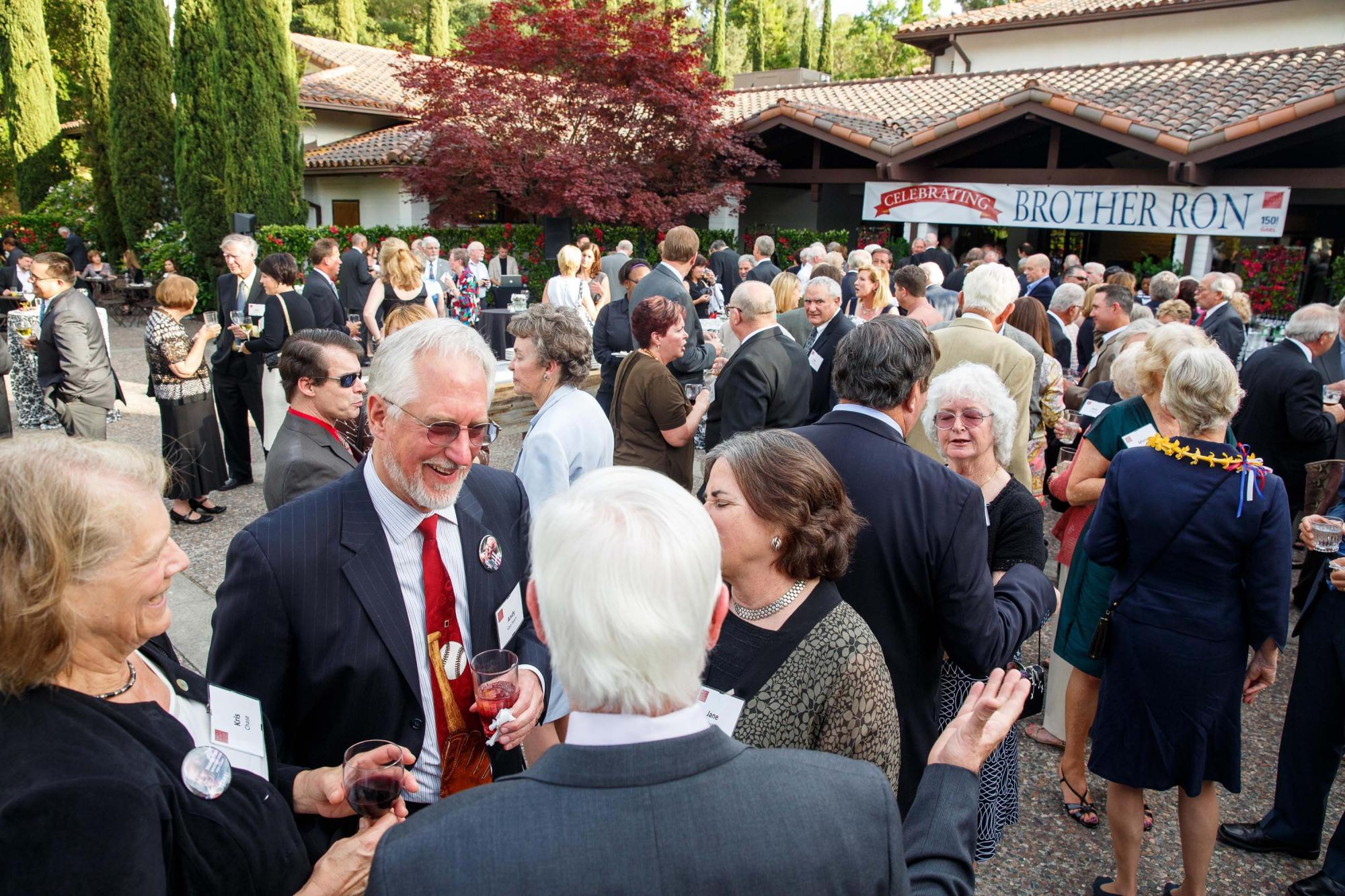 Guests caught up with each other at a festive pre-dinner reception in front of the Soda Center.