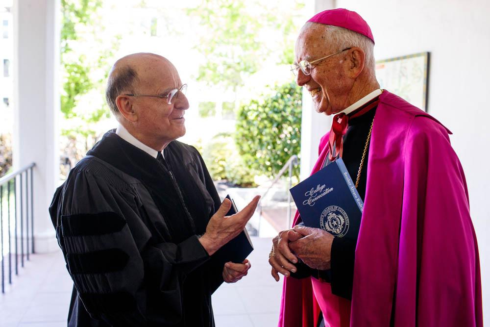 Brother Alvaro interacts with Bishop Emeritus John S. Cummins before the Convocation ceremony.