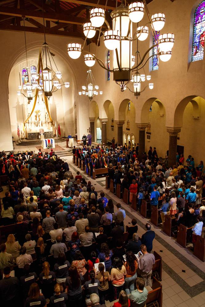 The SMC community stands together as Convocation begins in the SMC Chapel.
