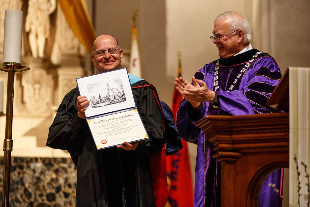 Brother Alvaro is awarded with an honorary doctorate in education from Brother President Ronald Gallagher.