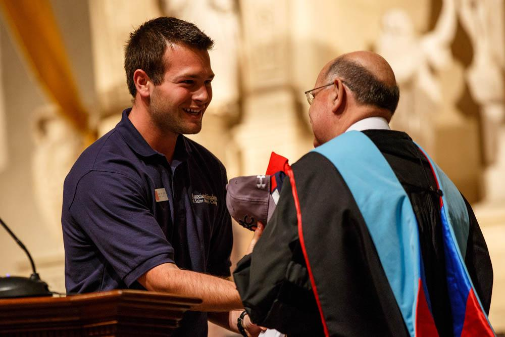 Associated Students President Joey Van Loon gives a gift to Brother Alvaro on behalf of the student body.