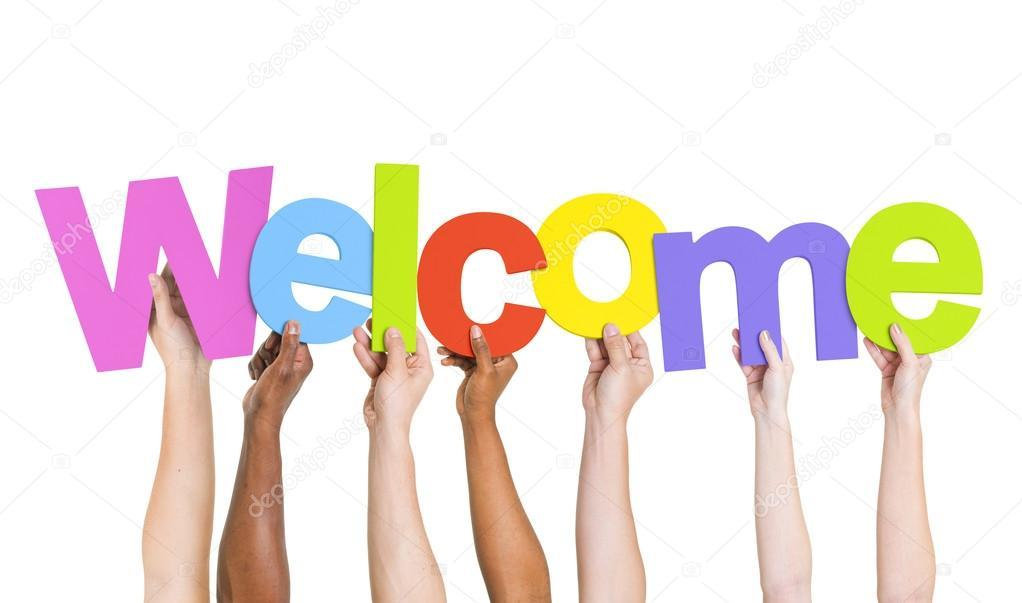 Different people of different skin colors, each holding one letter with the word spelling Welcome
