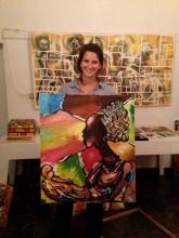 Meg Mulvaney with an 'inspired' Rwandan painting during Jan Term 2013