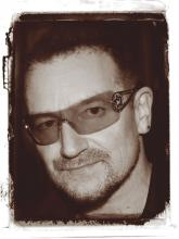 "Rock musician Bono, who has been nominated three times for the Nobel Peace Prize, is quoted in the book saying, ""Distance does not decide who is your brother and who is not."""