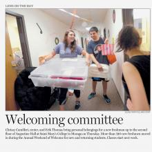 Contra Costa Times photo of student volunteers Chrissy Camilleri and Erik Thomas helping a first year student move into their dorm room during Weekend of Welcome.
