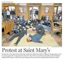"""Contra Costa Times photo of """"die-in"""" protest over Ferguson decision in Oliver Hall"""