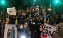 Protesters march down University Avenue in Berkeley.</body></html>