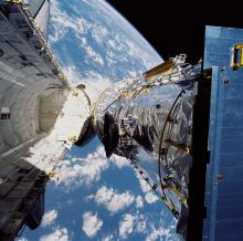 NASA's deployment of the Hubble Space Telescope in 1990.