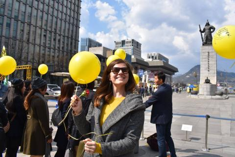 Danielle Wacker, PMBA Student, walking by a peaceful protest in South Korea