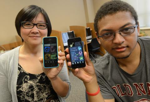 School of Science Prof. Wei Wei Pan and Elliot Battle '14 show iPhones displaying new app SMC students developed for the Lindsay Wildlife Experience.