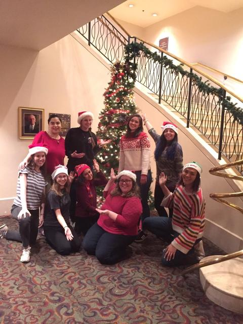Alejandra Rivas '19 with some of her coworkers decorating A.C.T. for the holiday season.