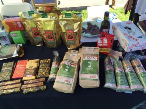fair trade coffee, chocolates, brownie mix, beans, and other items displayed on a table