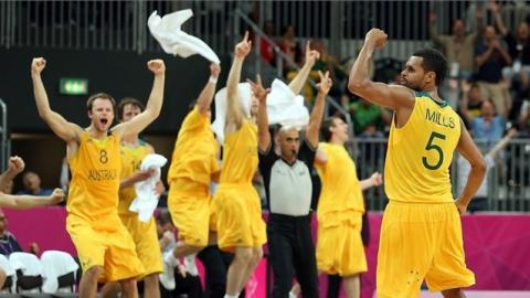 Patrick Mills of Australia celebrates winPatrick Mills (5) of Australia celebrates after making the game-winning three point shot against Russia in the final seconds of s Basketball preliminary round match.
