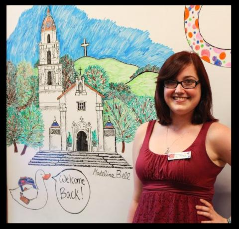 Lead Adviser Madeline Bell '15 with her drawing of the SMC Chapel. Come in and create your own whiteboard art!