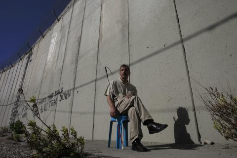 Hisham Ahmed is in the West Bank this summer serving as an observer in local Palestinian council elections. He was photographed near the wall between East Jerusalem and Abu Dis.