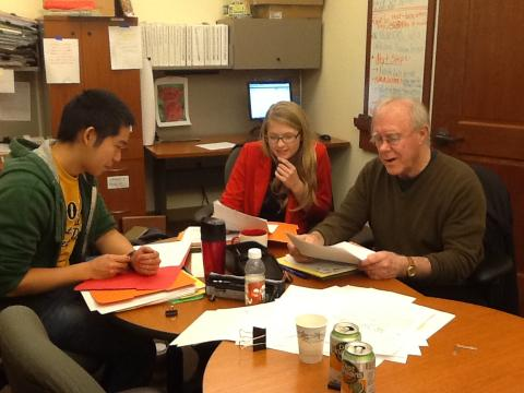 2012 MFA Graduates Andrew Taw and Casey McAlduff review entries with Robert Hass