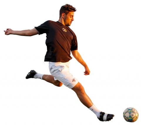 Man kicking a soccer ball.
