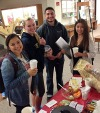 Students enjoying hot drink time during finals in the library.